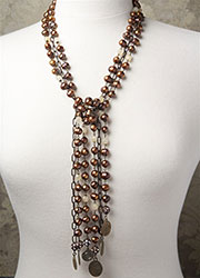 Long Multi-Stranded Rust Freshwater Pearls and Vintage Cream Beadings with Various Antique Medals
